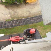 pose de descentes d_eau pluviales silos travaux à la corde